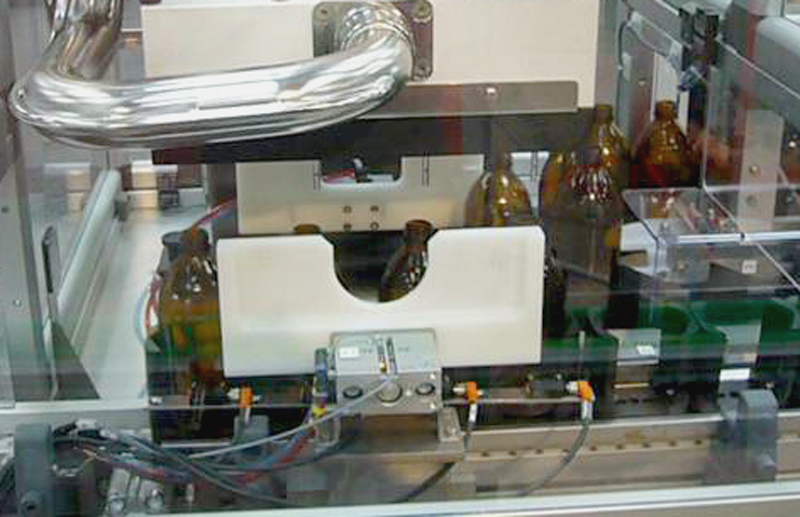IDI-Pharma-Souffleur-de-Flacons-avec-retournement-0